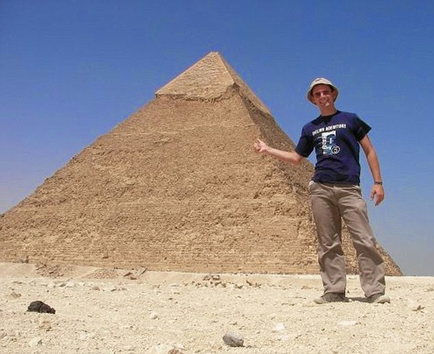 Jeremy Marie next to the pyramids in Egypt. - A Big Thumbs Up. Traveller Hitchhikes 100,000 Miles Around The World Without Spending Any Money