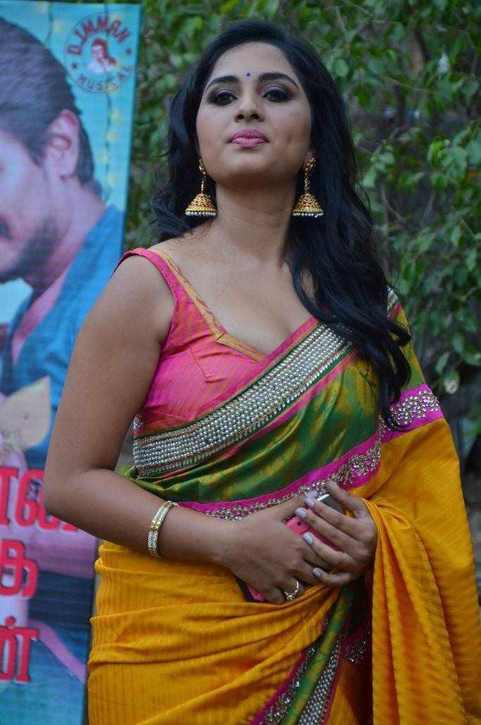 Beautiful Telugu Girl Srushti Dange Stills In Yellow Saree At Press Meet