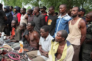 Photos: Police parade vicious gang that slaughtered 19 villagers, 2 officers in Niger State including a father and son after collecting ransom