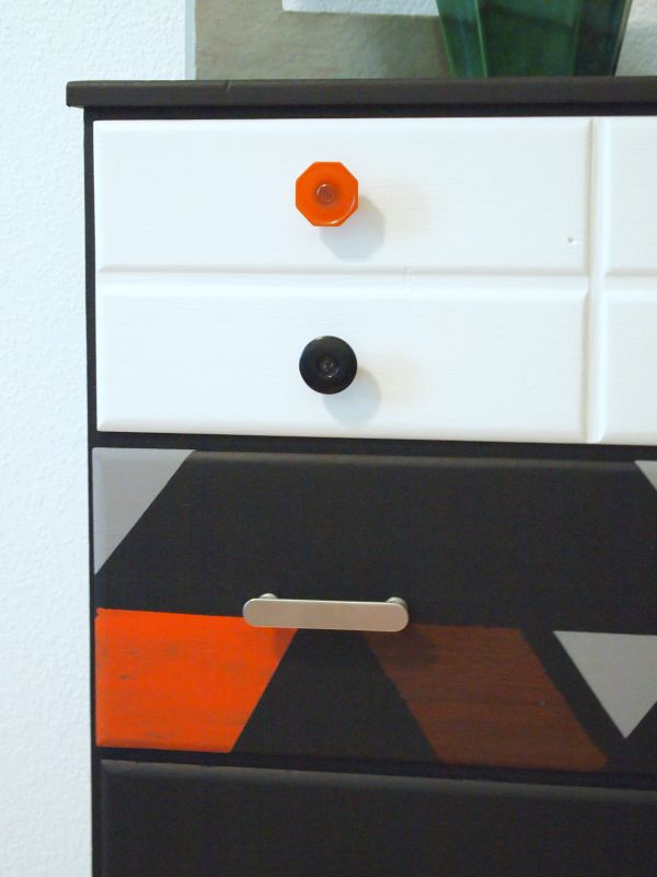 Make your own knobs and drawer pulls, courtesy D. Lawless Hardware, to compliment a geometric paint pattern on an otherwise drab dresser.