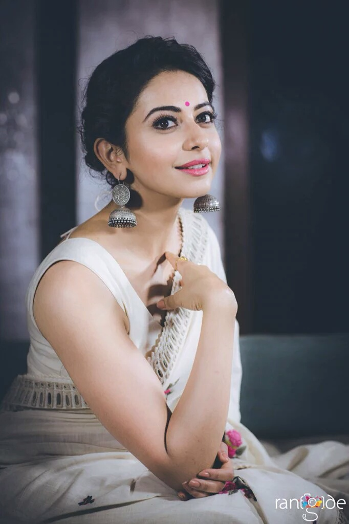 South Indian Actress Rakul Preet Singh Hot Photo shoot In Sleeveless White Saree