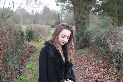 Monochrome winter outfit, with patterned check trousers fur collared coat and chelsea boots. Beauty Blogger OOTD. Curled Hair
