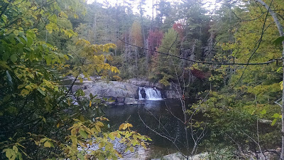 Linville Falls under a cloudy sky in early autumn