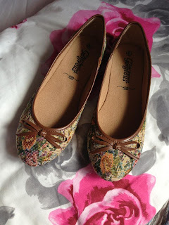A pair of dolly shoes