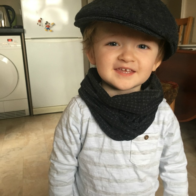 Sun-and-ice-toddler-in-cap-and-scarf