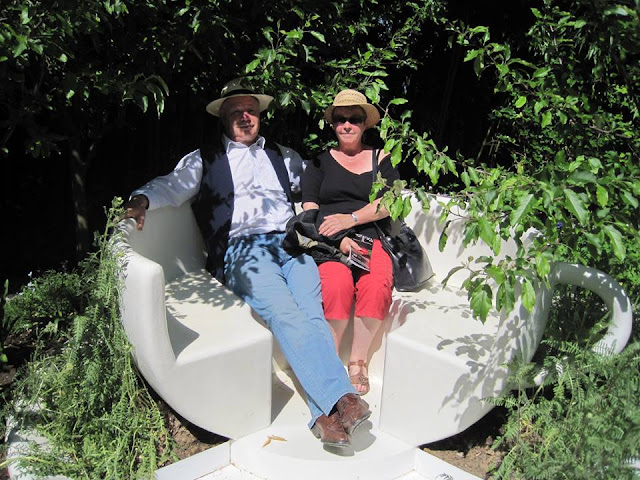 Couple sittingin giant cup at the International Garden Festival at Chaumont-sur-Loire
