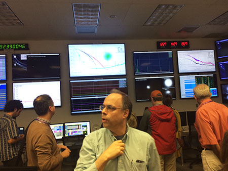 Inside the LLO control room as LSU Professor Joe Giaime leads the tour (Source: Palmia Observatory)