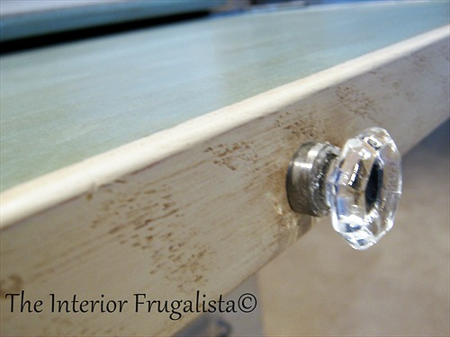 Glass knob on faux secretary desk