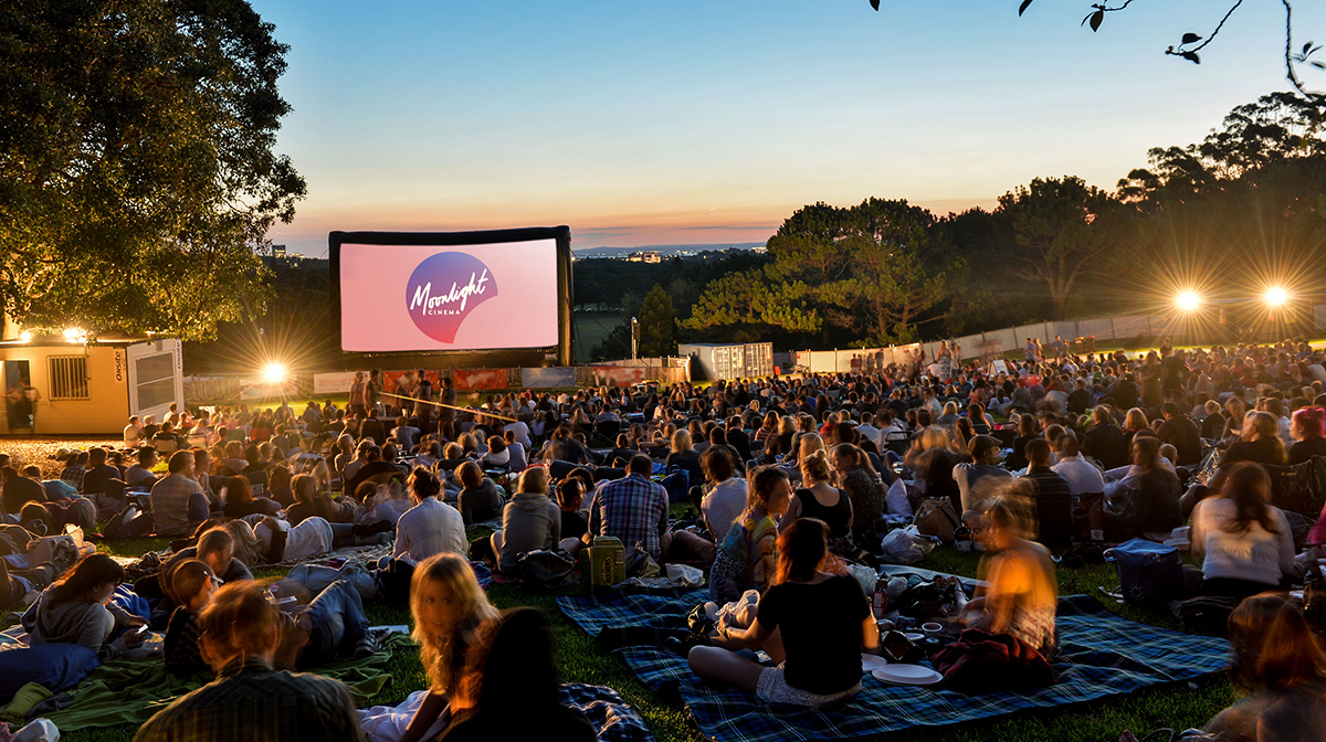 Lawns of Centennial Park at dusk with movie goers for a dog-friendly Moonlight Cinema session