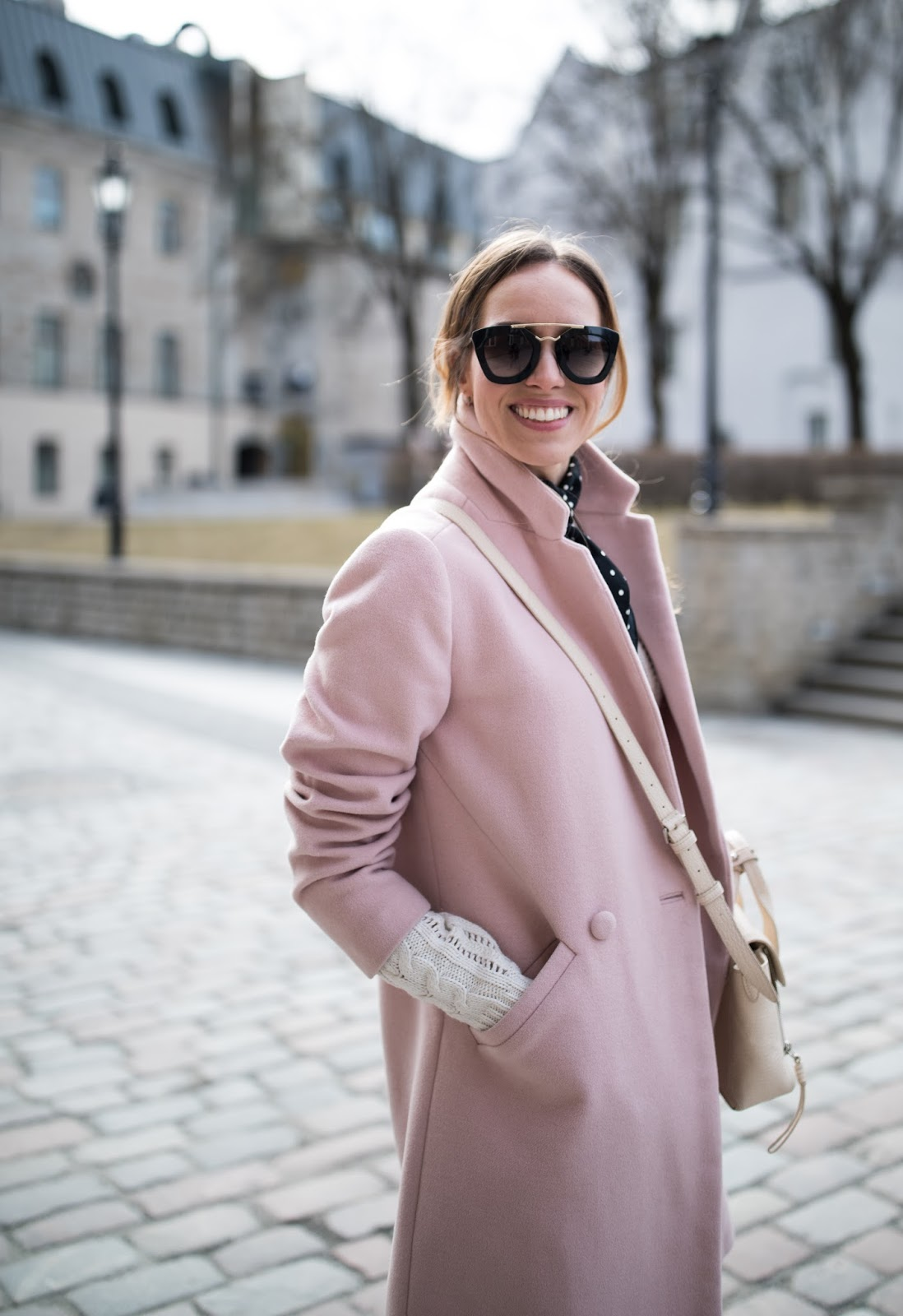 pink coat minimalist outfit