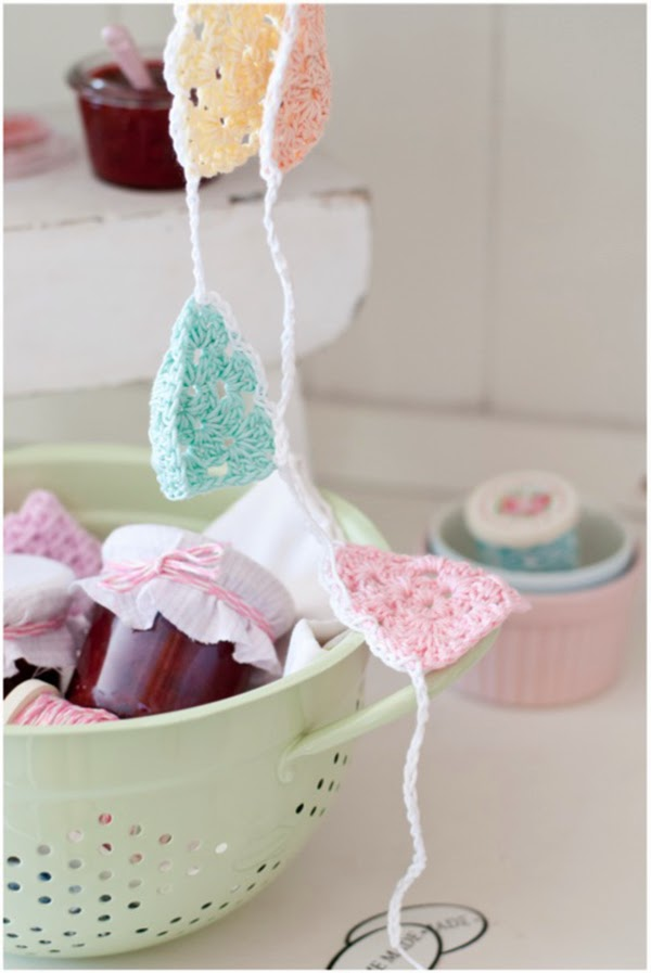 crochet bunting and homemade jam in colander