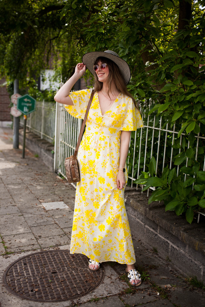 Outfit: yellow 70s maxi dress, striped wide brim hat