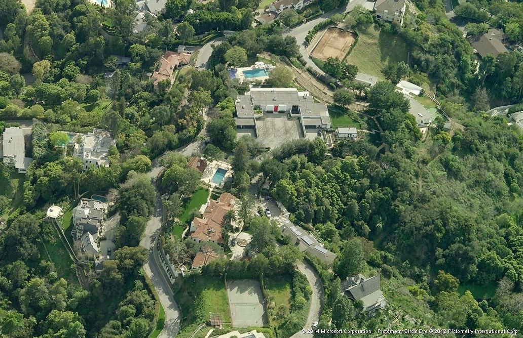 An even higher aerial view looking down the mountain. Notice the old red door to the mansion.