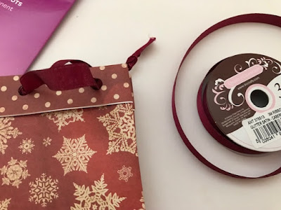 Making ribbon handles for a gift bag