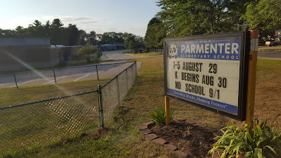 Parmenter school sign with the opening week schedule