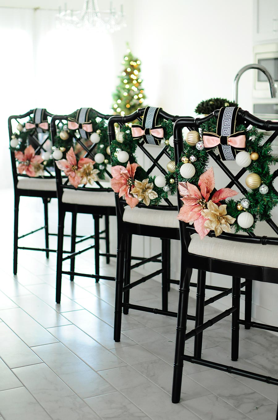 DIY blush pink or millennial pink chair wreaths made with dollar store items.