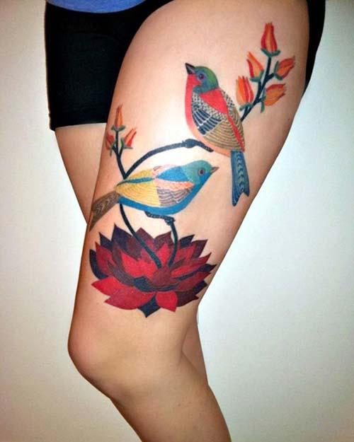 kadın üst bacak kuş dövmesi woman thigh bird tattoo