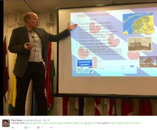 Pic of Dr van Oostrum presenting alongside slide on Frisian culture