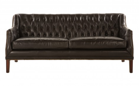 Upholstered vintage black leather sofa with brass nail heads and a tufted back