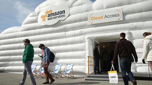 Visitors arrive at the cloud pavilion of Amazon Web Services at the 2016 CeBIT digital technology trade fair in Hanover, Germany