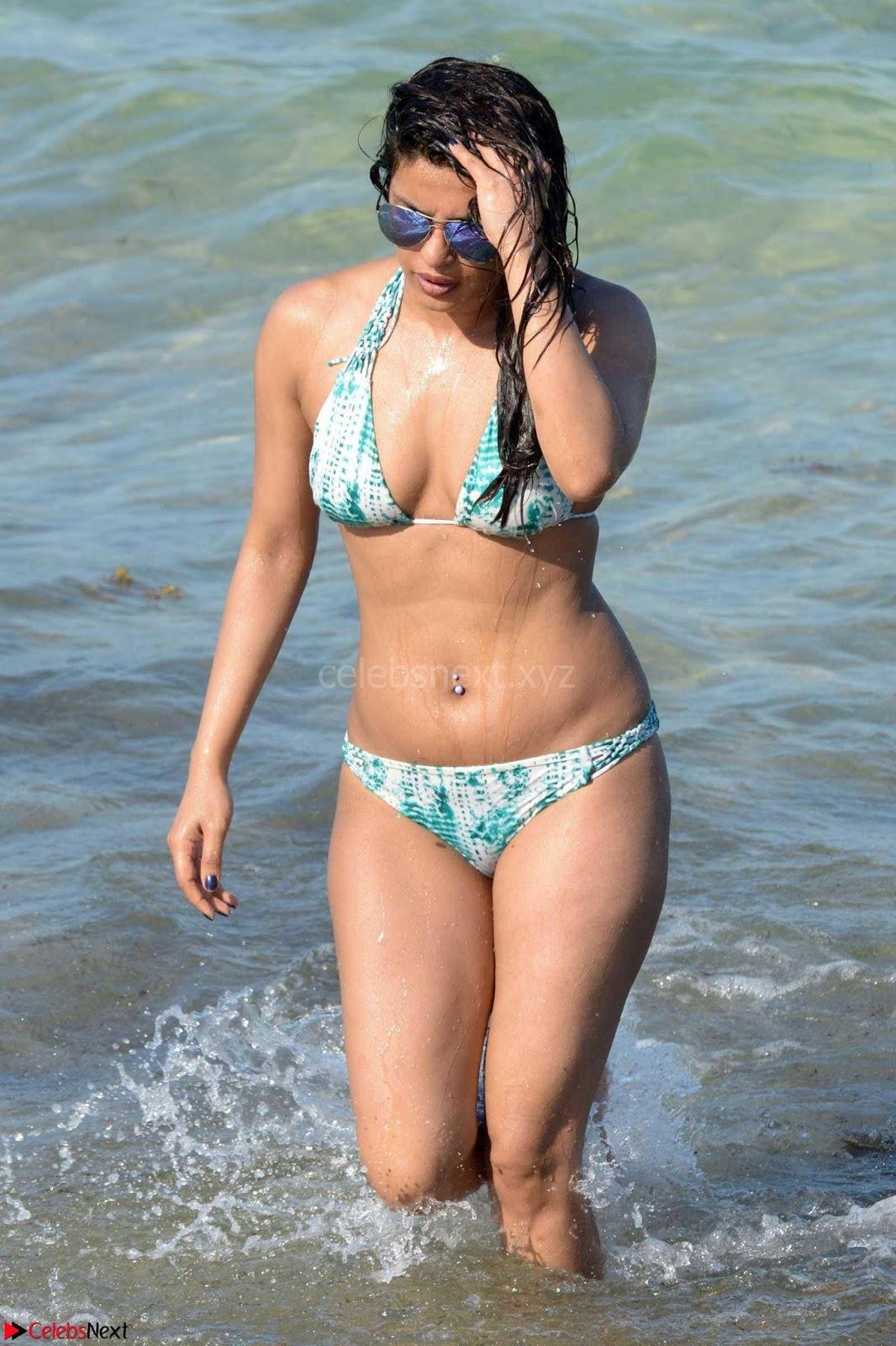 Priyanka Chopra on beach in White and green Bikini Enjoying Miami Day 5 ~ CelebsNext Exclusive
