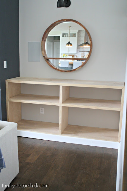 Built in bookcase by fireplace