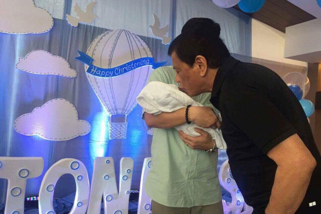 President Rodrigo Duterte kisses his grandson, Marko Digong