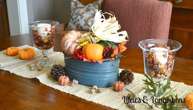 simple fall center piece display blue orange and pumpkins