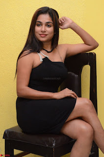 Vrushali Gosavi in strapless Short Black Dress At Follow Follow U Audio Launch 028.JPG