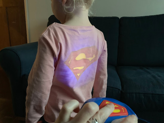 Projection of the Herodrive Superman Signal Squad Cars on to a toddlers back