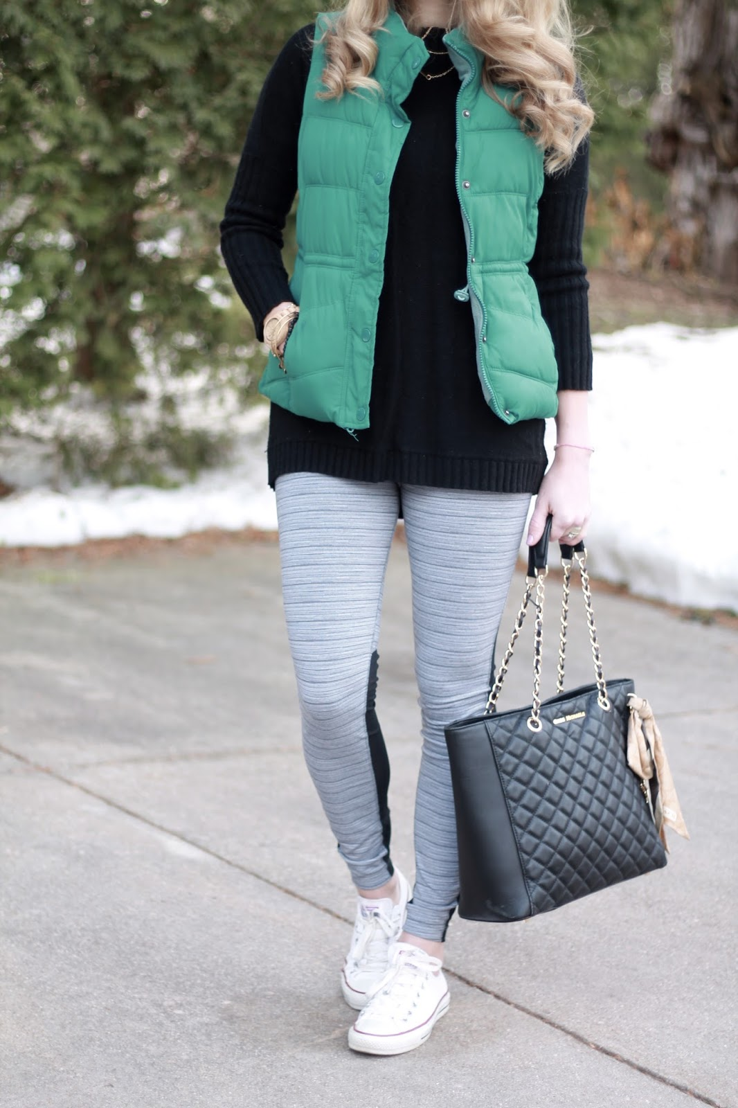 black tunic sweater, grey and mesh leggings, turquoise puffer vest, converse shoes, Greg michaels tote