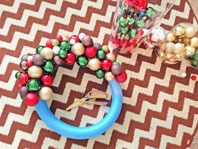 Image result for gluing ornaments to noodle wreath