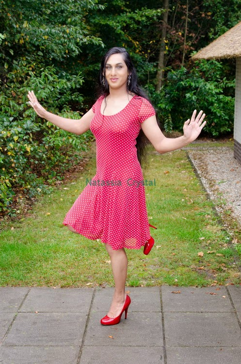 Natassia Crystal natcrys, red polka-dot dress, outside balancing one leg stand