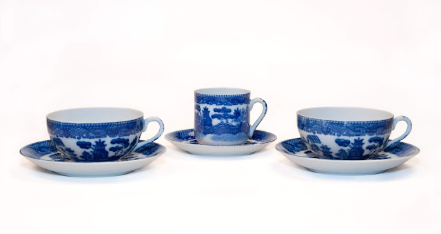 Two Blue Willow china teach cups, with a very fine china demi-tasse cup.