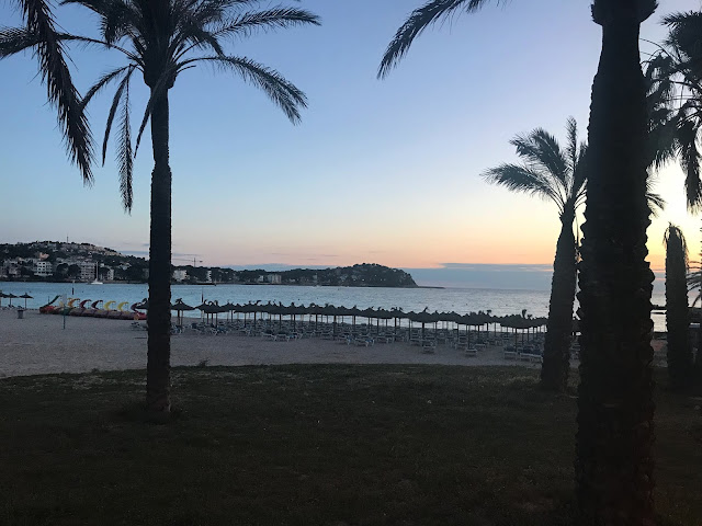 the sunset over the beach in majorca