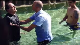 One of the group's baptisms. Screen grab: The Last Reformation/YouTube