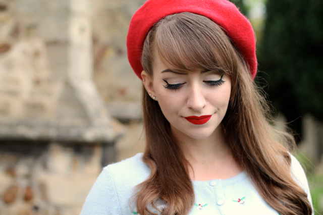 Red beret with blue cardigan