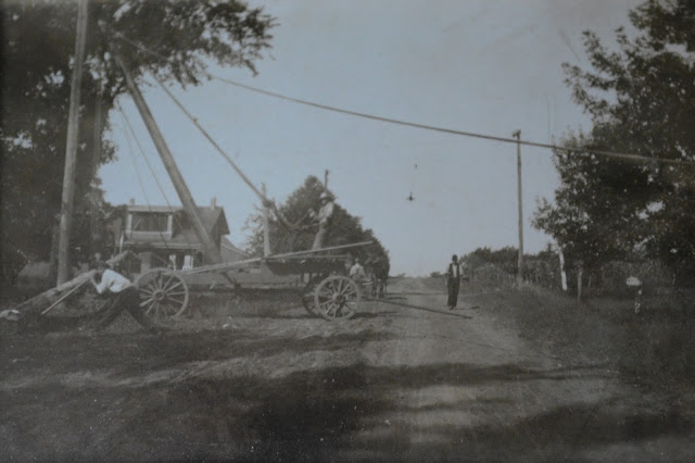 vintage photo of S Grove Street Normal Illinois getting utility pole