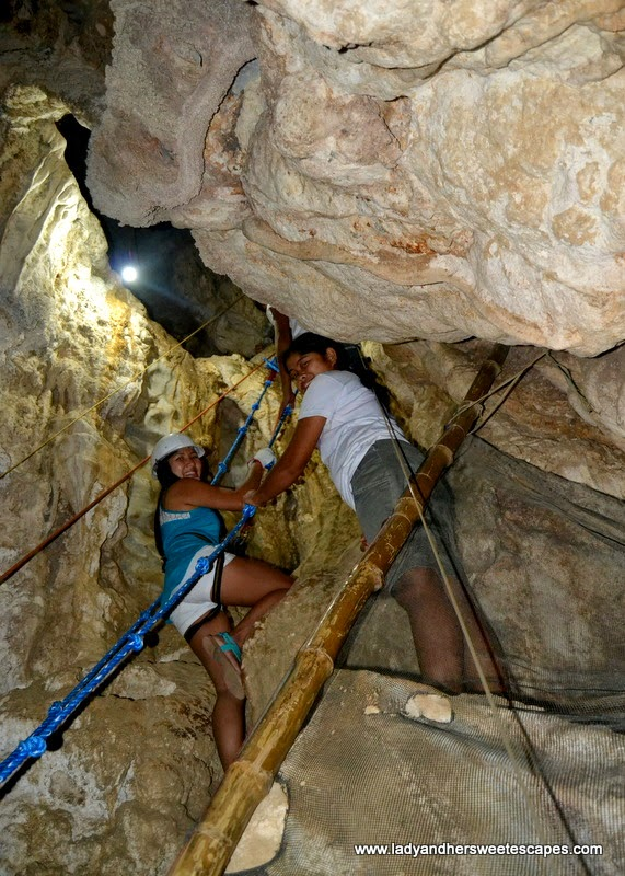 Lady in Ugong Rock Adventure's spelunking area