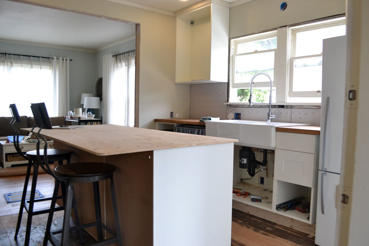 renovate kitchen update sinks and install kitchen island For now we have a piece of plywood serving as the counter We did this for two reasons First we want to use the island But most of all we re trying to