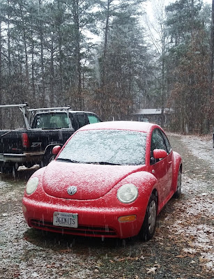 Red VW Beetle's first snow fall