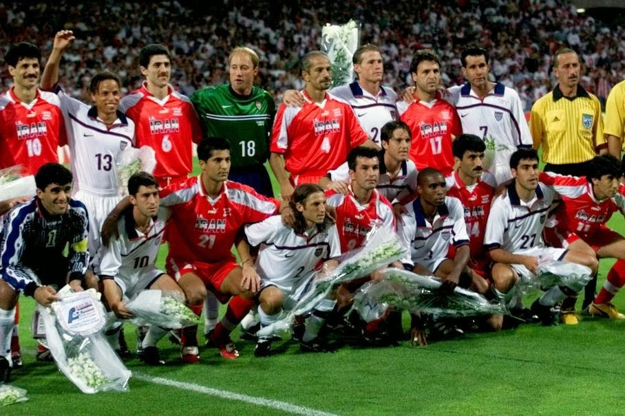 In this Sunday, June 21, 1998 file photo, US and Iranian team players pose for a group photo, before the start of their World Cup first round soccer match, at Gerland Stadium, in Lyon, France. On this day: US and Iran seek to keep lid on differences. The World Cup often throws up geopolitical clashes.