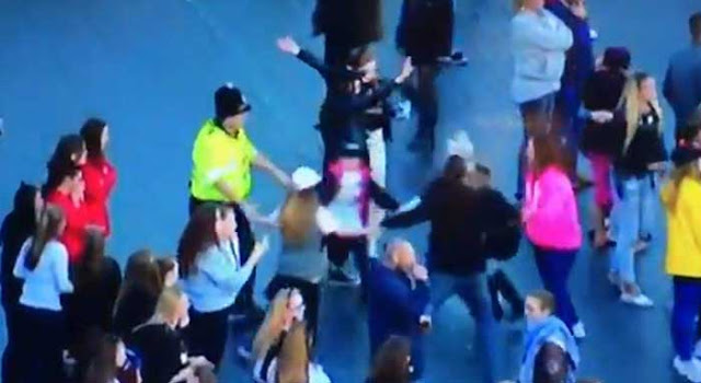 Manchester cop dances with children during 'One Live Manchester' concert