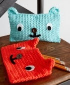 http://www.yarnspirations.com/patterns/grin-and-bear-it-case.html