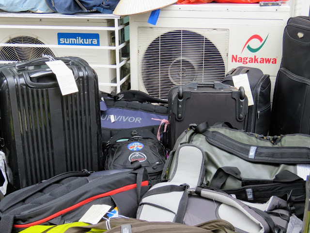 Luggage waiting to board Paloma Cruises in Halong Bay Vietnam