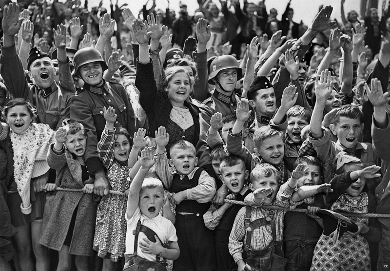 19 June 1940 worldwartwo.filminspector.com German women children Nazi salute