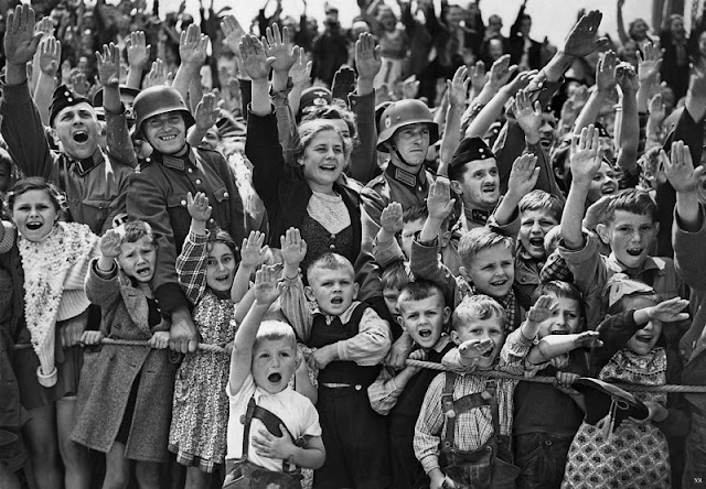 19 June 1940 worldwartwo.filminspector.com German women children German salute