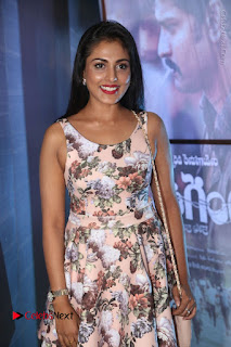 Actress Madhu Shalini Stills in Floral Short Dress at RGV Shiva to Vangaveeti Event  0034.JPG