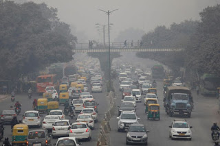 Vehicles drive through smog in New Delhi, India, on Dec 5, 2017. (Photo Credit: Reuters) Click to Enlarge.