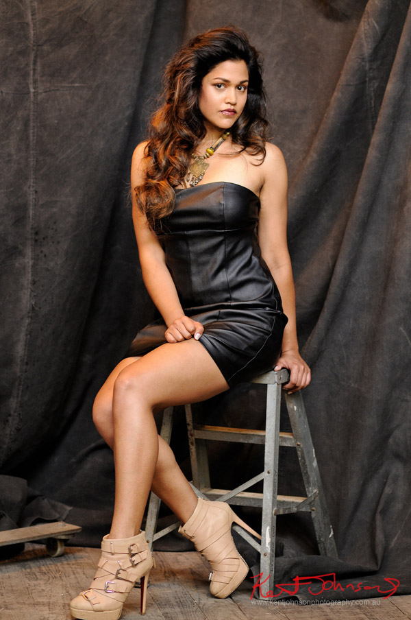 Seated shot, studio modelling portfolio shoot, black leather evening dress.
